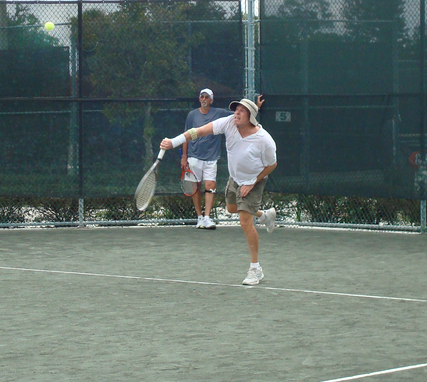 Two men playing tennis at the Payne Park Tennis Center