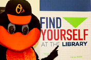 Find Yourself at the Library with the Baltimore Orioles mascot.