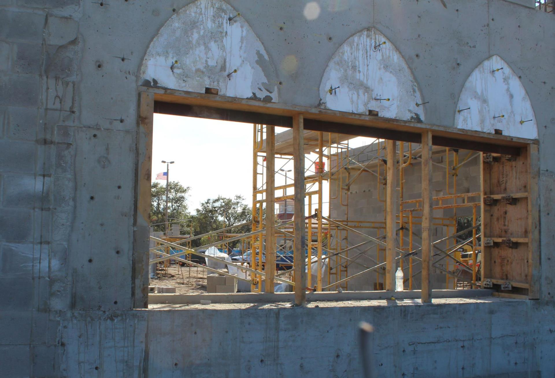Getting the window arches framed and cement poured.