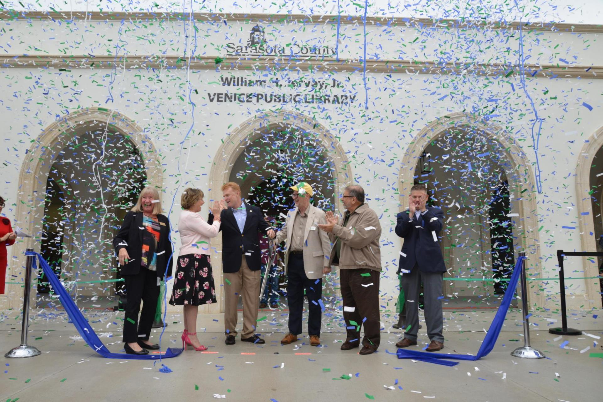 Confetti fills the area as key leaders cut the ribbon, officially opening the William H. Jervey Jr. Venice Public Library Dec. 15, 2018.