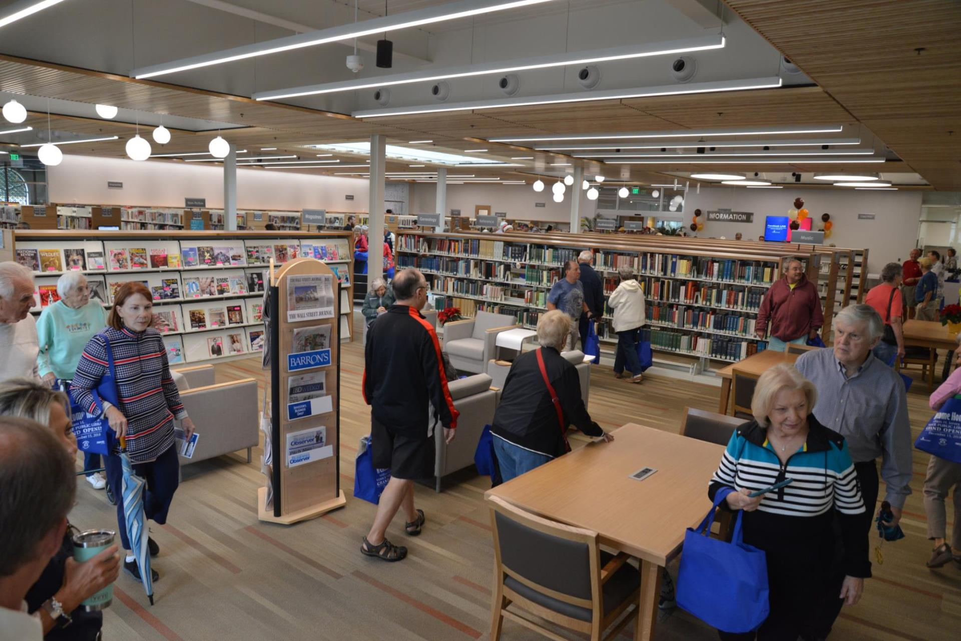 Community members explore the new William H. Jervey Jr. Venice Public library following its ribbon-cutting ceremony Dec. 15, 2018.