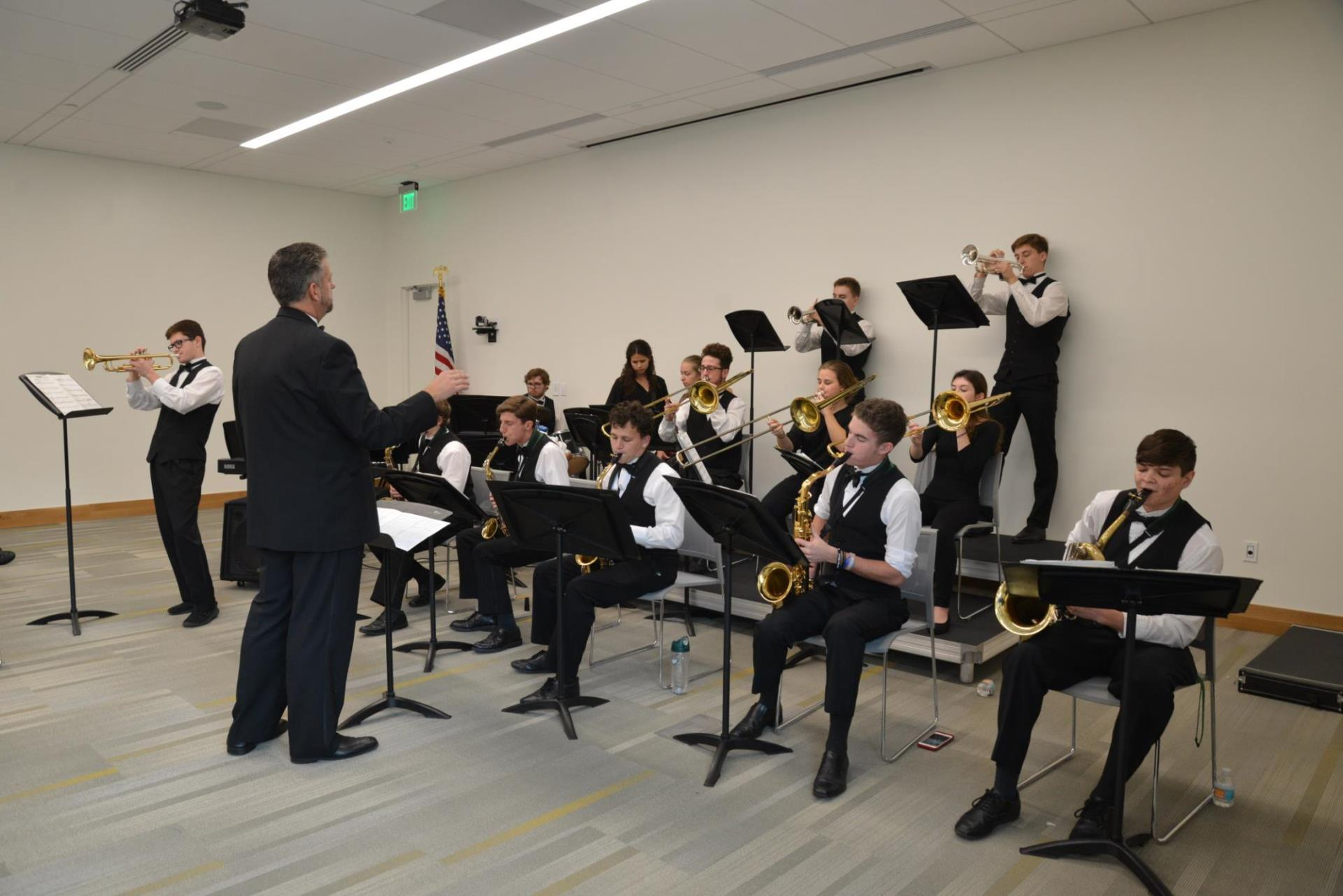 Venice High School student-musicians perform as community members explore the new William H. Jervey Jr. Venice Public library following its ribbon-cutting ceremony Dec. 15, 2018.
