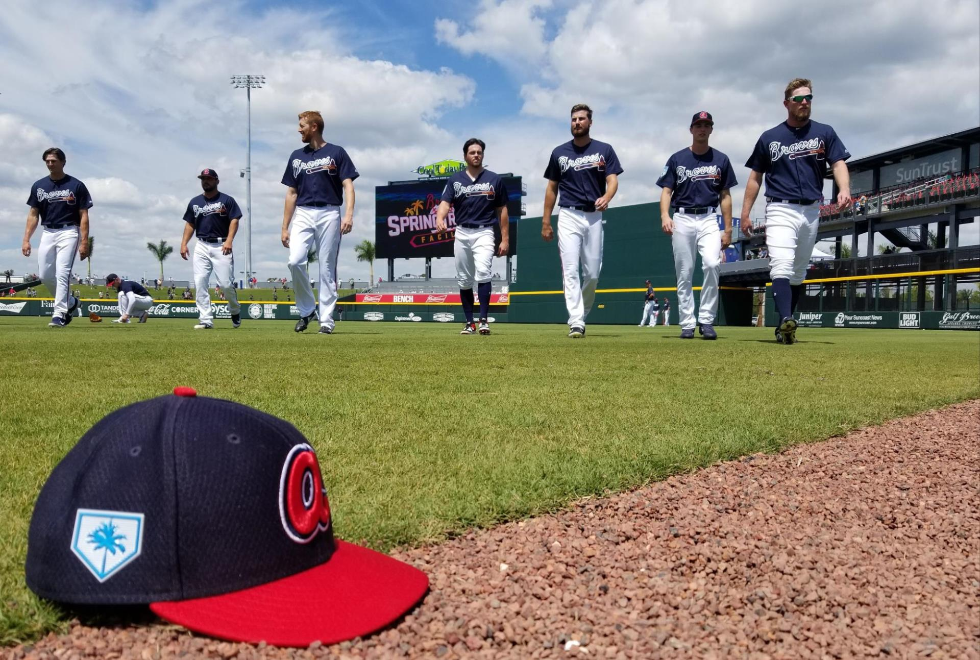 Atlanta Braves players warm up before their first game in the team's new spring training facility in Sarasota County. The field mirrors the team's field in their regular season home in Atlanta.