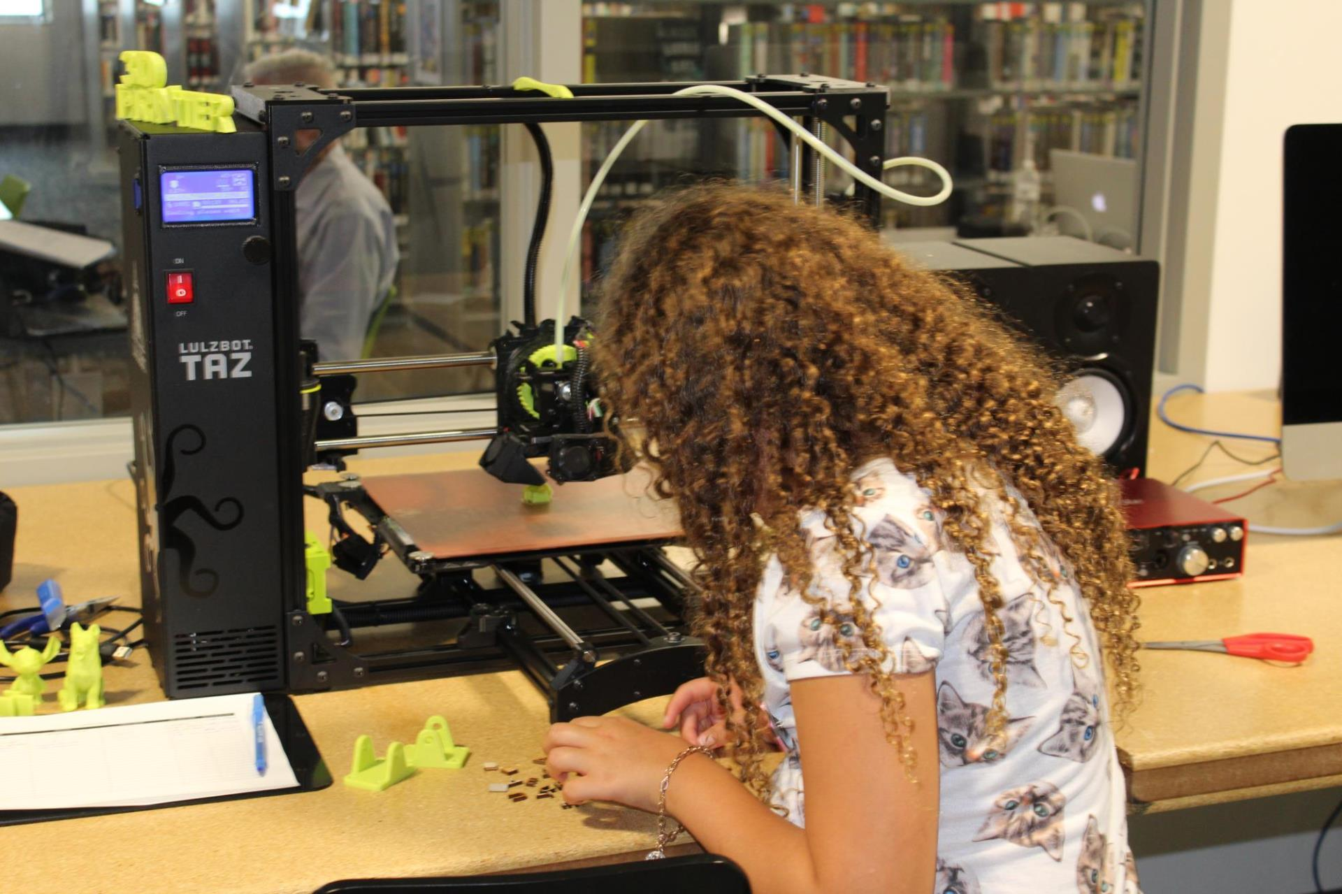 Young patron using 3D printer
