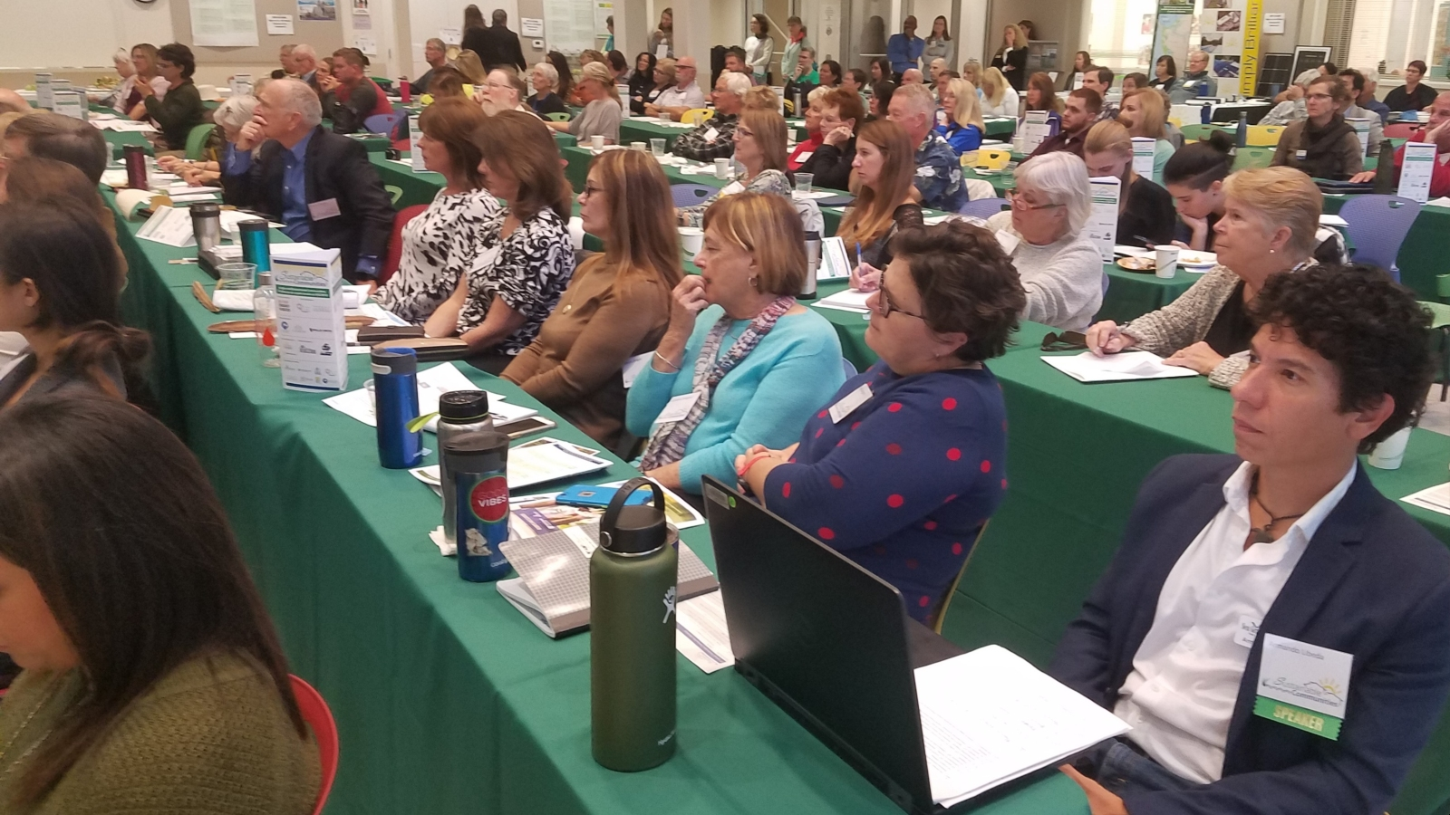 Audience members watch a presentation at the 2018 Sustainable Communities Workshop in Sarasota, Florida