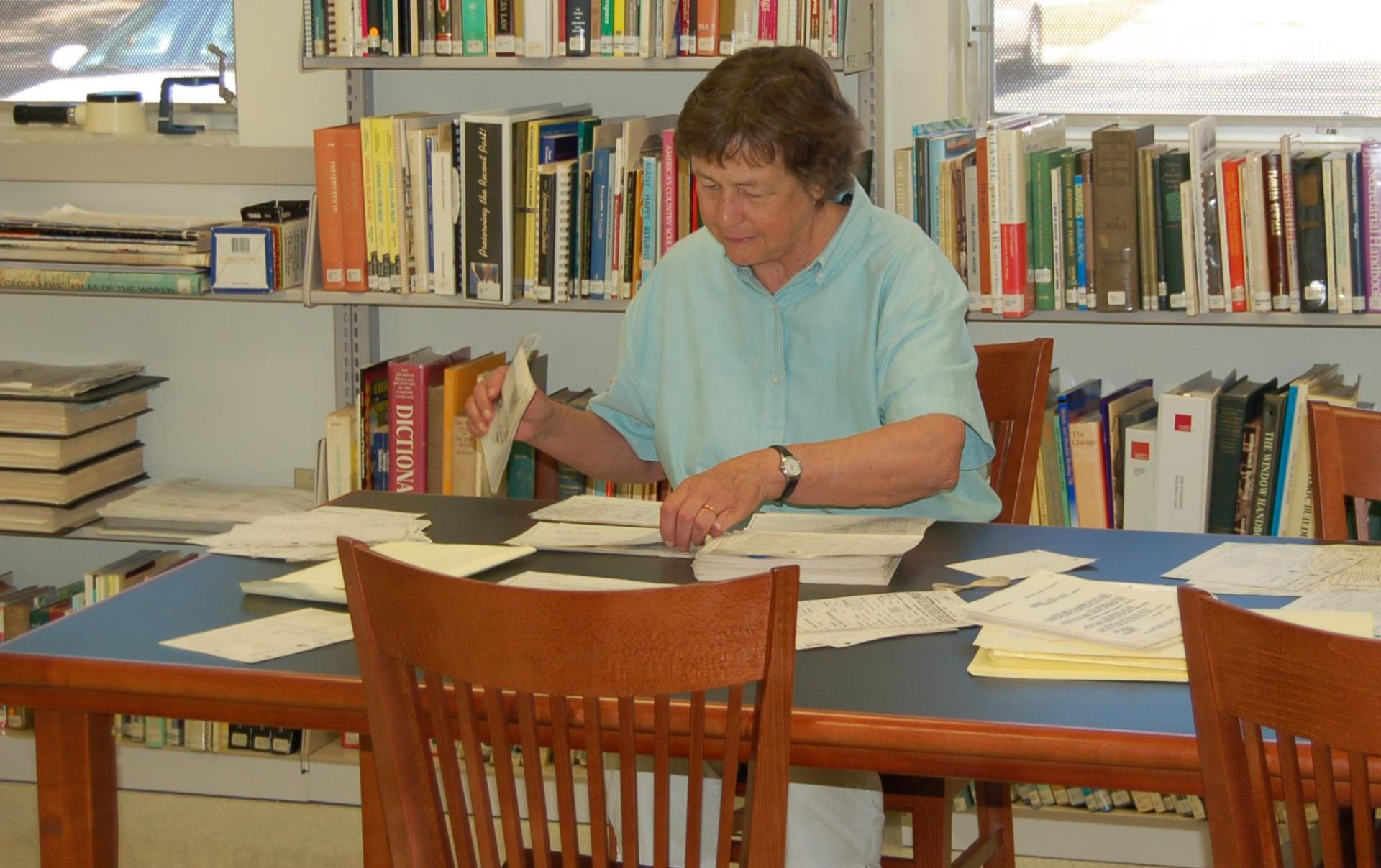 History Resources volunteer sorting research materials