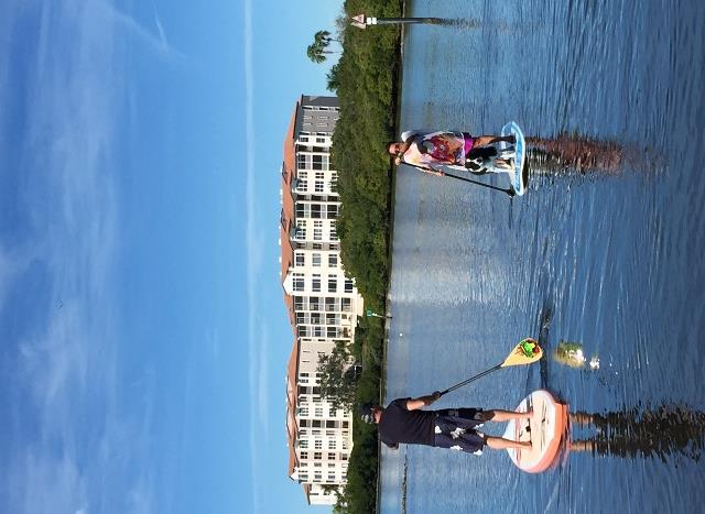 Couple paddle boarding at Phillippi