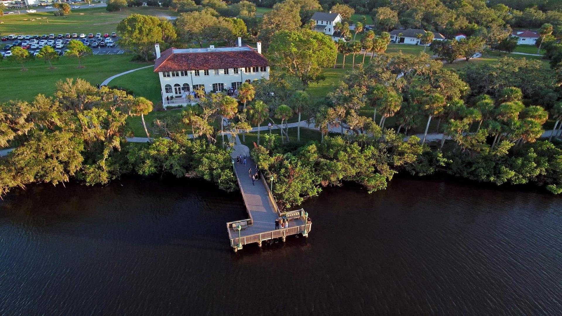 Aerial wedding photo of a wedding at the Phillippi Estate Park mansion, view from the back of the mansion