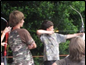Two young boys practicing archery, 4H members.