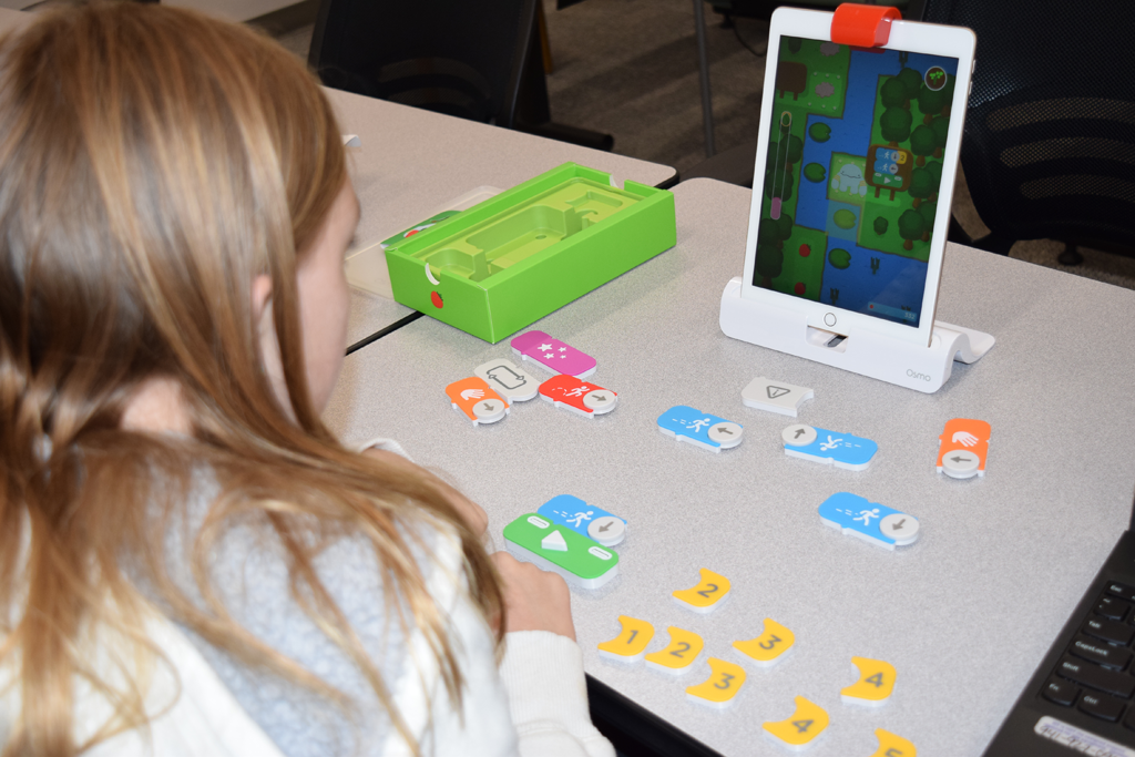 Patron learning to code with Osmo
