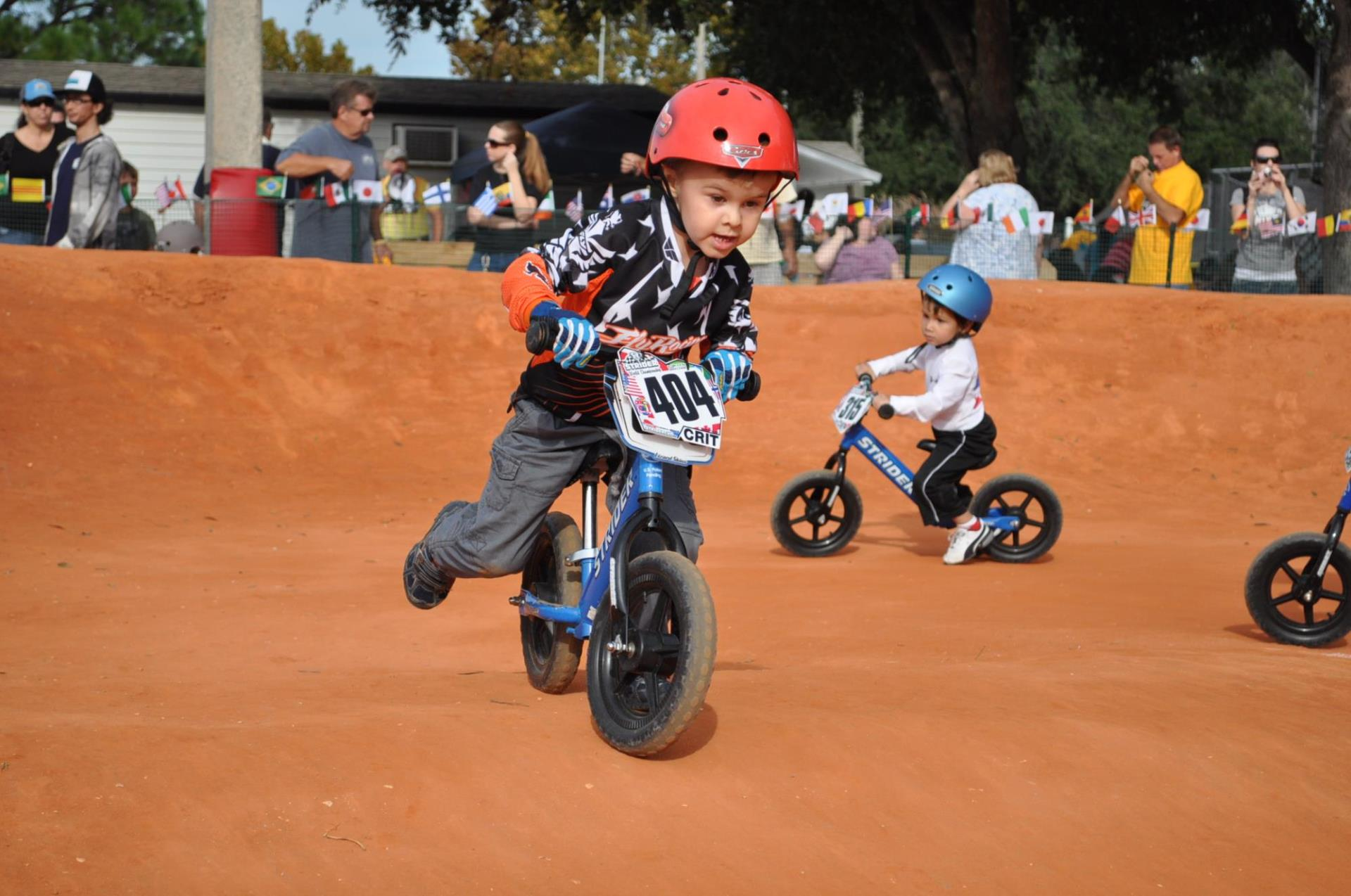 Young Strider bike ride at the BMX track